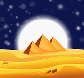 Cartoon Egyptian pyramids in the desert with star night sky Royalty Free Stock Photo