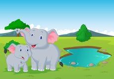 Cartoon elephant family near watering hole Royalty Free Stock Photography