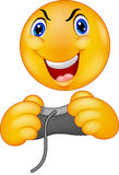 Cartoon Emoticon smiley playing video game Royalty Free Stock Photography