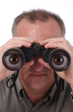 Cartoon Eyes in Binoculars. Man looking through binoculars with magnified cartoon eyes in the lenses; isolated on white; see two other versions, one normal, one Stock Images