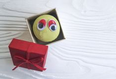 Cartoon eyes tasty macaron on a wooden box snack. Cartoon eyes macaron on a wooden box tasty snack Royalty Free Stock Photo