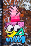 Cartoon face graffiti design, London UK Stock Image