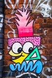 Cartoon face graffiti design, London UK Stock Image