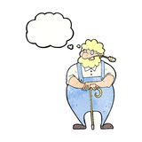 Cartoon farmer leaning on walking stick with thought bubble Royalty Free Stock Image
