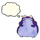 cartoon fat frog with thought bubble Stock Image