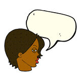 Cartoon female face with narrowed eyes with speech bubble Royalty Free Stock Image
