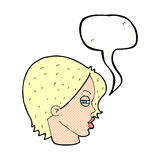 Cartoon female face with narrowed eyes with speech bubble Royalty Free Stock Images