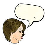 Cartoon female face with narrowed eyes with speech bubble Stock Photo