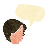 Cartoon female face with narrowed eyes with speech bubble Stock Photography