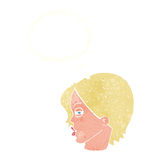 Cartoon female face with narrowed eyes with thought bubble Stock Images