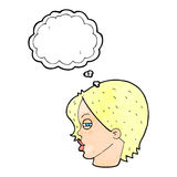 Cartoon female face with narrowed eyes with thought bubble Stock Image