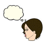 Cartoon female face with narrowed eyes with thought bubble Stock Photo