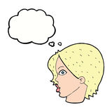 Cartoon female face staring with thought bubble Stock Photo