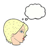 Cartoon female face staring with thought bubble Stock Photography