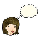 Cartoon female face with thought bubble Stock Images