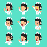 Cartoon female nurse faces showing different emotions. For design Stock Images