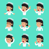 Cartoon female nurse faces showing different emotions set. For design Royalty Free Stock Photo