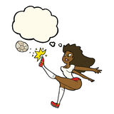 Cartoon female soccer player kicking ball with thought bubble Stock Photo