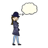 Cartoon female spy with thought bubble Stock Photo