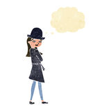 Cartoon female spy with thought bubble Royalty Free Stock Image