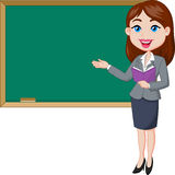 Cartoon female teacher standing next to a blackboard Stock Images