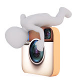 Cartoon Figure Climbing on Instagram Camera Icon. Generic Gray 3d Cartoon Figure Climbing on top of Large Oversize Instagram Camera Icon and Looking into Lens in Stock Photos