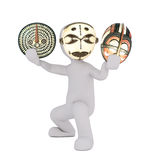 Cartoon Figure Holding and Wearing Tribal Masks Royalty Free Stock Photography