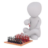 Cartoon Figure Making Move in Chess Game. Generic Gray 3d Cartoon Figure Sitting Crossed Legged on Floor and Holding Red Playing Piece While Looking Down at Red Royalty Free Stock Photography