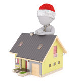 Cartoon Figure in Santa Hat with Miniature House. Real Estate Concept Image - 3d Rendering of Cartoon Figure Wearing Neck Tie and Santa Hat Leaning Against Roof Royalty Free Stock Photos