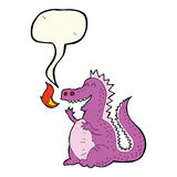 Cartoon fire breathing dragon with speech bubble Stock Images
