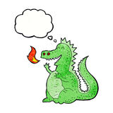 Cartoon fire breathing dragon with thought bubble Stock Image