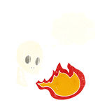 Cartoon fire breathing skull with thought bubble Stock Photos