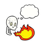 Cartoon fire breathing skull with thought bubble Royalty Free Stock Images