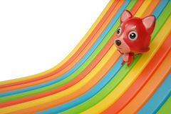 A cartoon firefox down on rainbow slide 3D rendering Stock Image