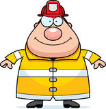 Cartoon Fireman Smiling. A cartoon fireman standing and smiling Royalty Free Stock Image