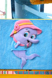 Cartoon fish wearing hat. Stock Images