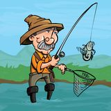 Cartoon fisherman catching a fish. He is standing in a river Royalty Free Stock Image