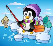 Cartoon fishing penguin Stock Images