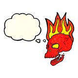 Cartoon flaming skull with thought bubble Stock Photo