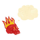 Cartoon flaming skull with thought bubble Stock Photos