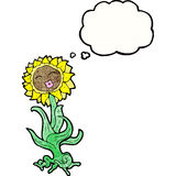 cartoon flower with face Stock Images