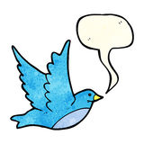 Cartoon flying bird with speech bubble Royalty Free Stock Photo