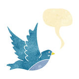 Cartoon flying bird with speech bubble Royalty Free Stock Photos