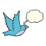 Cartoon flying bird with thought bubble Stock Images