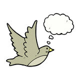 Cartoon flying bird with thought bubble Stock Photos