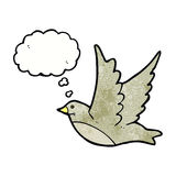Cartoon flying bird with thought bubble Royalty Free Stock Image