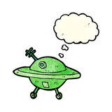 Cartoon flying saucer with thought bubble Royalty Free Stock Images