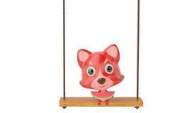 A cartoon fox eating a watermelon on the swing,3D illustration. Royalty Free Stock Photography