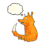cartoon fox sitting with thought bubble Stock Photography