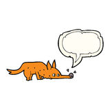 Cartoon fox sniffing floor with speech bubble Stock Images